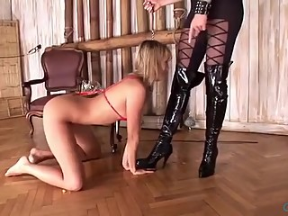 Girl slave licks the boots to her mistress