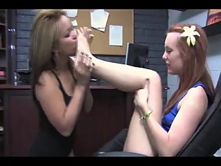 Lesbian licks her redhead friends feet and soles