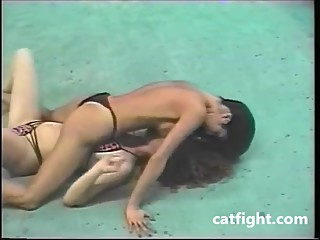 Two great athletes are doing competitive topless submissive sex on Catfight