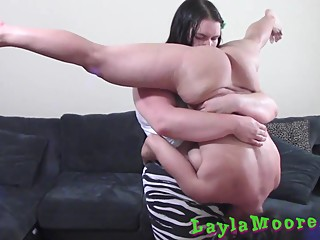 BBW lifts smaller girl in a standing 69